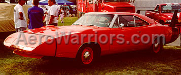 [A Red Dodge Charger Daytona, Photographed From The Left]